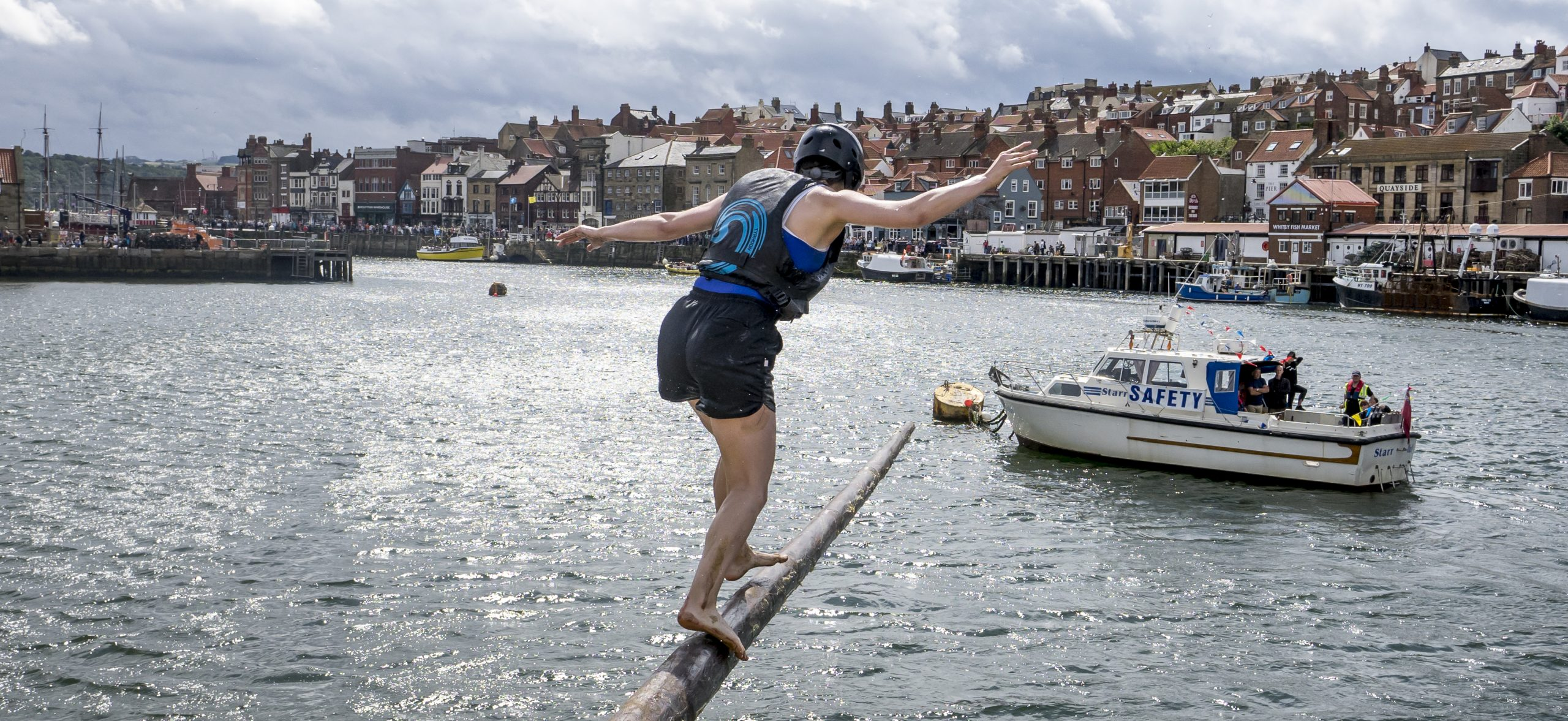 balancing on a pole over Whitby Harbour