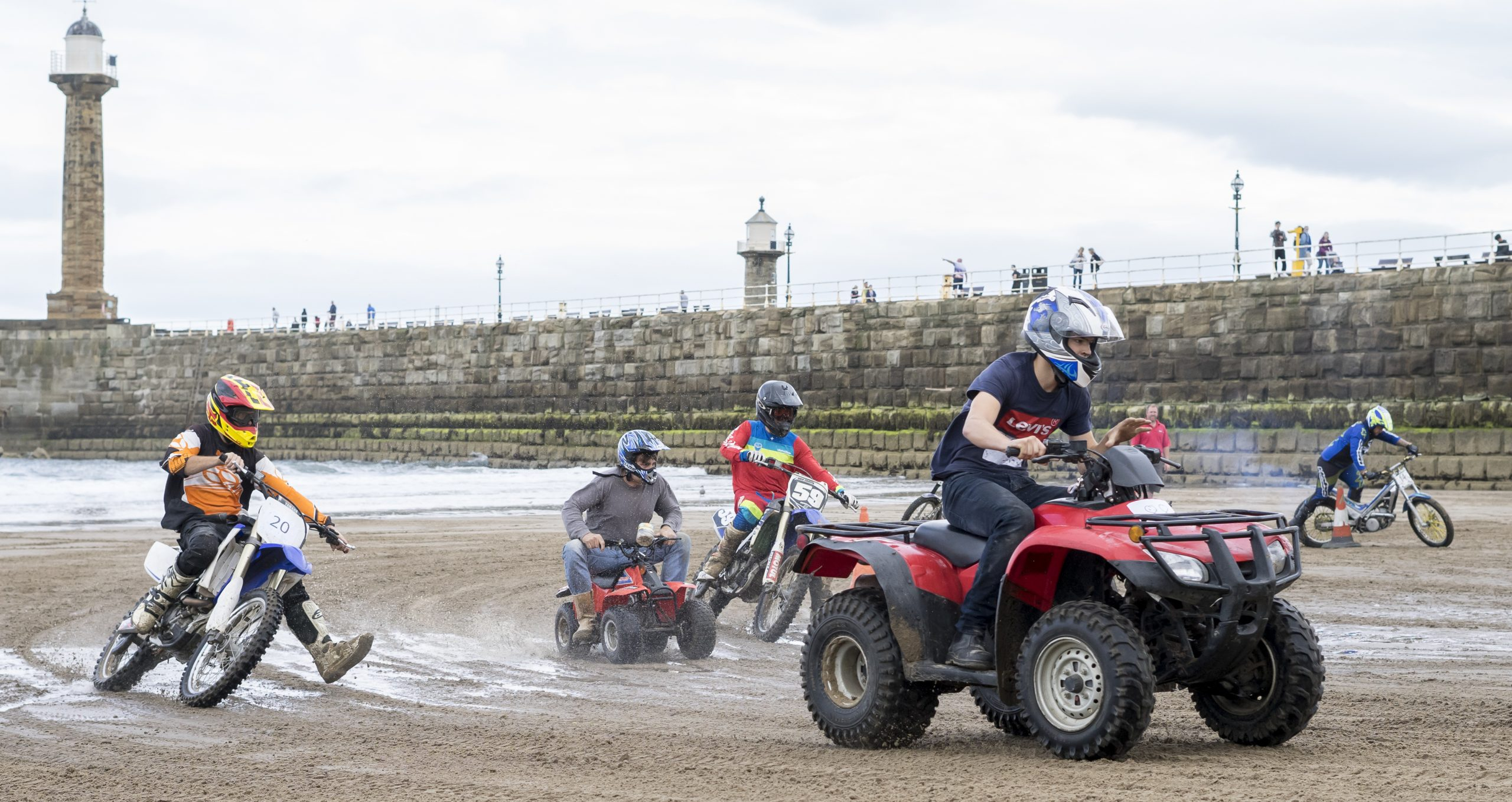 motor bikes racing on Whitby beach